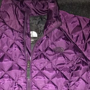 Purple North face puffer jacket